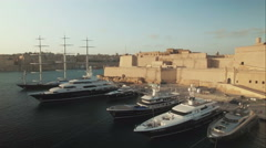 Aerial Shot - Flying over a Fort and luxury Yachts Stock Footage