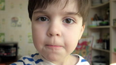 Close up of boy eating cereal Stock Footage