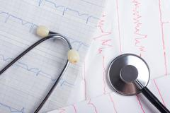 Cardiogram pulse trace and stethoscope concept for cardiovascular medical exam Stock Photos