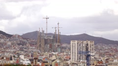 Sagrada Familia telephoto view, famous building rise above city roofs Stock Footage