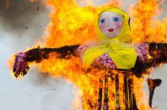 Burning of stuffed of Shrovetide - stock photo