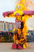 People are looking at burning of effigies of Shrovetide Stock Photos