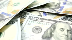 Male hand picking up hundred dollar bills - stock footage