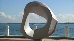 "Speed boat passes ""inside"" the sculpture on Brickell Bay Drive, in Miami. Stock Footage"