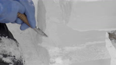 Ice Carving with a chisel. Ice sculptures - stock footage
