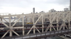 Cabs and cars crossing Queensboro Bridge over East River in NYC Stock Footage