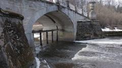 Water flowing underneath the old bridge. Stock Footage