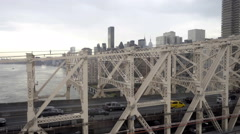 Cars, taxis driving across Queensboro Bridge toward Manhattan skyline NYC Stock Footage