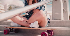 Teenager girl at the beach on steps eating ice cream Stock Footage