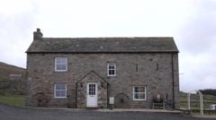 Old historic rock farm house Scotland England border fast 4K Stock Footage