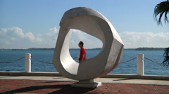 Zoom out from hole in a sculpture at Brickell, Miami. Stock Footage