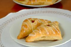 Homemade apricot pie in the shape of a trian, cake - stock photo
