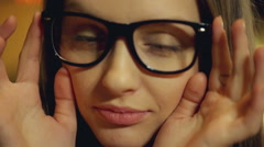 Girl taking off glasses and smiling to the camera Stock Footage
