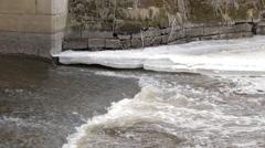 Spring water stream underneath mossy old bridge. Stock Footage