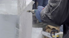 Ice Carving with a power tool. Ice sculptures Stock Footage