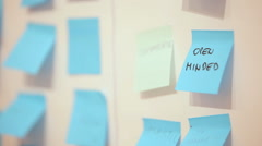 Wall full of post  notes, Open Mind text in focus Stock Footage