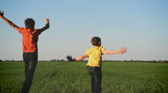 Happy young children  running and jumping  on nature Stock Footage