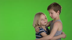 Big brother comforts his little brother in front of greenscreen - stock footage