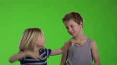 Brothers playing together in front of greenscreen Stock Footage