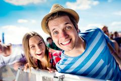 Detail of teenagers at summer music festival enjoying themselves Stock Photos