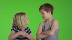 Two kids have conflict and they turns around back to back Stock Footage