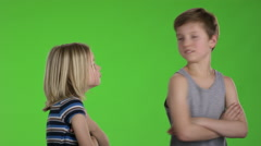 Two kids have a conflict and turns around back to back Stock Footage