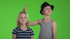 Older Brother with hat tease younger brother in front of camera while they ar Stock Footage