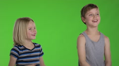 Two brothers are playing together in front of greenscreen Stock Footage