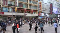 Pedestrians walk through popular Nanjing Road in Shanghai Stock Footage