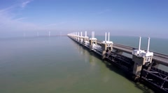 Aerial flying slowly parallel west side of Oosterscheldekering 4k - stock footage