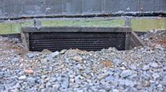 Dug hole for basement house window Stock Footage