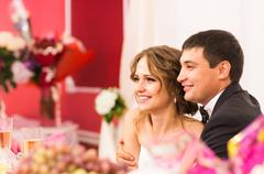 Newlyweds  sitting together. Celebration, wedding reception in a restaurant - stock photo