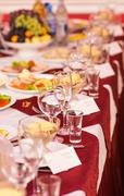 catering table set service with silverware, napkin and glass at restaurant - stock photo
