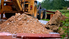 Pile of gravel from digging long shot Stock Footage