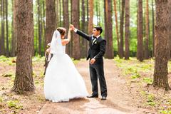 Bride and groom dancing  in nature. Wedding dance outdoors Stock Photos