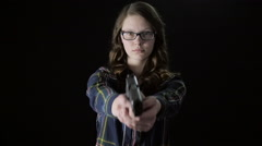 Female with Glasses Raises Handgun in Slow Motion Stock Footage
