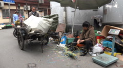 Electronics recycling, poverty, woman cuts wires in Shanghai, China, Asia - stock footage