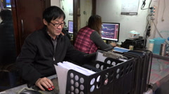 Chinese small scale investors trading at Shanghai stock exchange Stock Footage