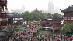 People visit the Yuyuan Gardens, a popular tourist attraction in Shanghai, China - stock footage