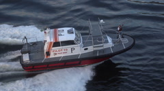 Pilot boat approaches ship to drop off pilot - stock footage