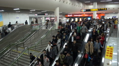 Commuter subway passengers on escalators in Shanghai station, China Stock Footage