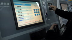 A Chinese man buys a ticket for the subway in Shanghai Stock Footage