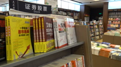 Books for sale about trading stocks shares commodities in Shanghai China Stock Footage
