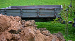 Parking trailer behind a pile of dug fresh dirt Stock Footage