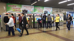China Shanghai commute, passengers purchase tickets from vending machine - stock footage