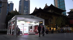 Cosmetics stand in front of a temple at dusk in Shanghai Stock Footage