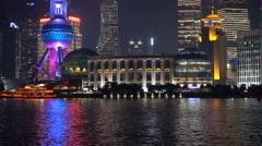 Closeup illuminated buildings of Shanghai skyline, night, evening, neon lights Stock Footage