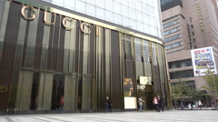 Large Gucci store in central Shanghai, designer label shopping in China - stock footage