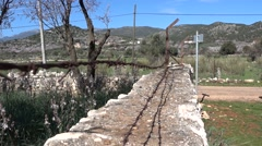 Wall with barbered wire at the countyside Stock Footage