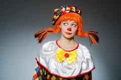 Clown in funny concept on dark background Kuvituskuvat